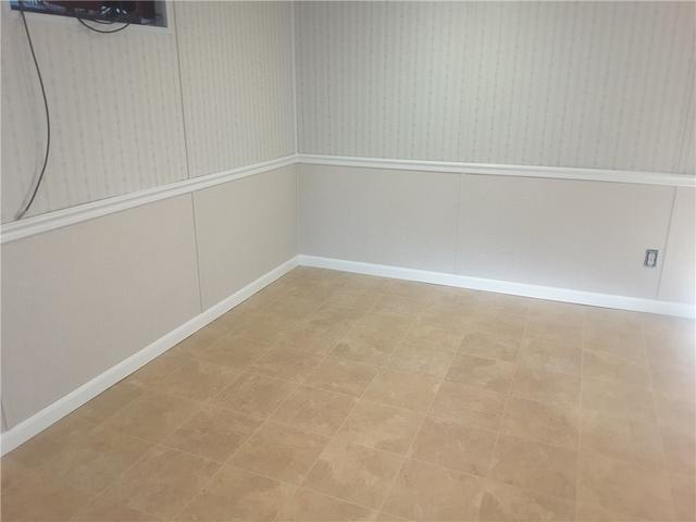 ThermalDry Flooring and EverLast Half-Wall Transforms Basement to Beautiful