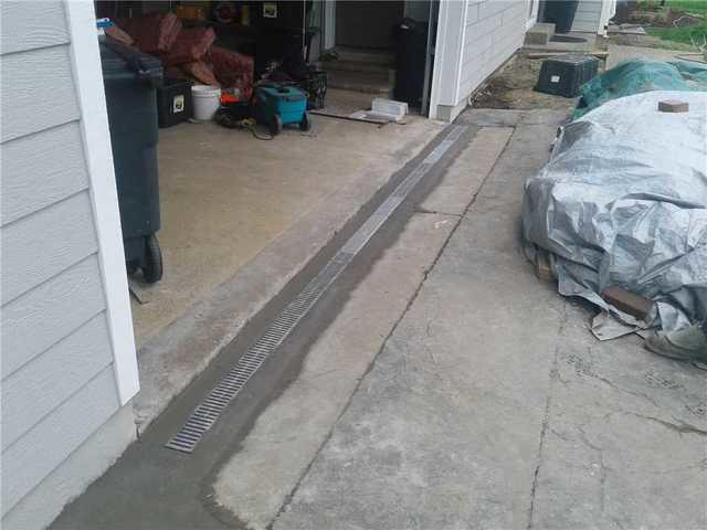 Exterior Trench Drain on Saint Louis, MO Driveway