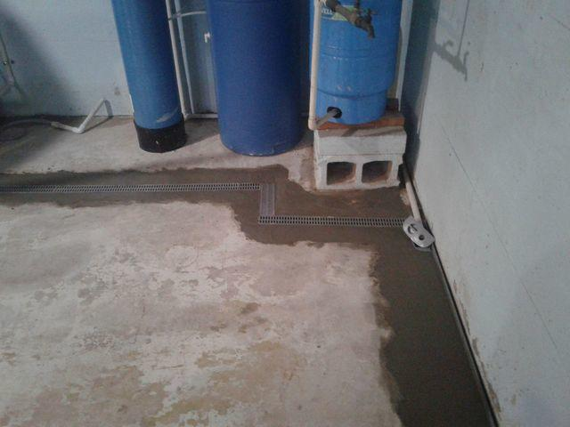 Red Bud, Illinois Water Stained Basement Floor Protected with WaterGuard