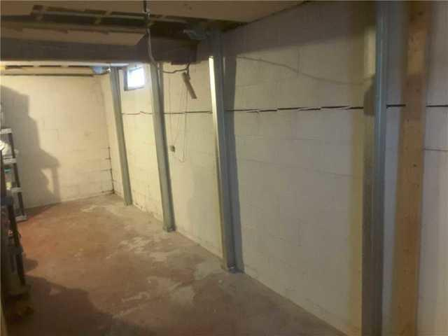 Bowing Basement Walls Supported With PowerBrace In Longview, IL
