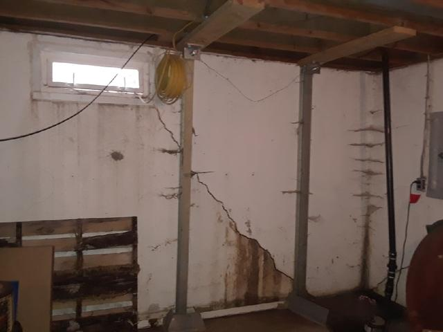 Badly Cracked Granite City, IL Basement Walls Supported With PowerBrace