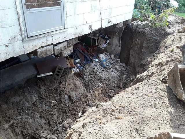 Collapsed Basement Wall Rebuilt In Farina, IL
