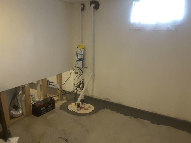 Wet Waterloo, IL Basement Fitted With WaterGuard And TripleSafe