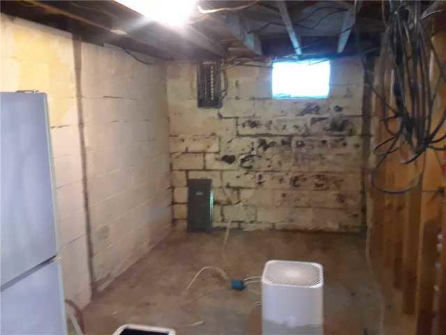 Badly Cracked Waterloo, IL Basement Walls Supported With GeoLock