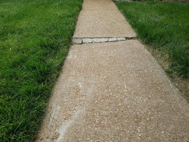 Repairing Broken Sidewalk with PolyLevel System - Before Photo