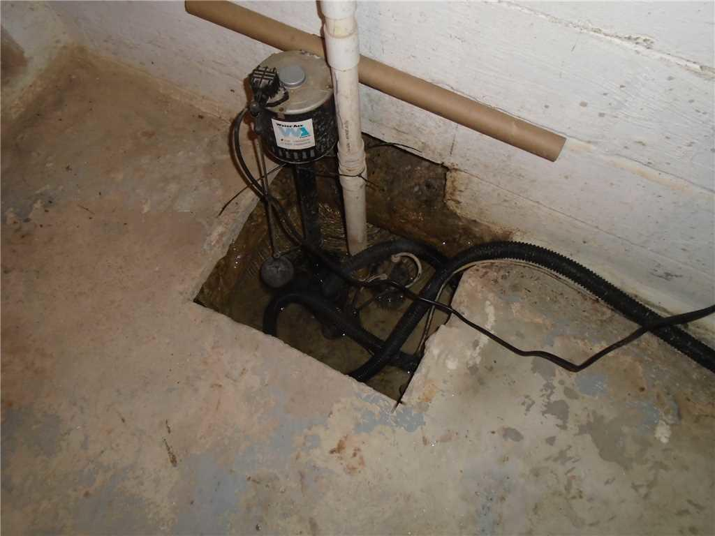 Old Sump Pump vs. New SuperSump Installed in Columbia, SC Basement - Before Photo