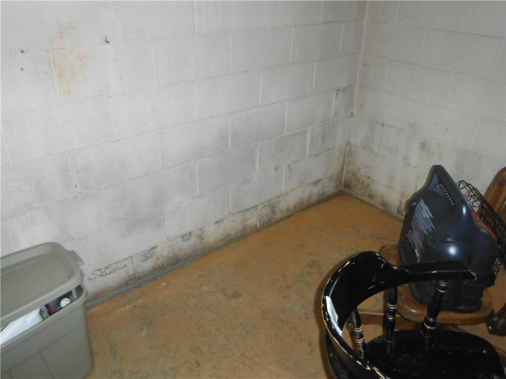 WaterGuard and SuperSump Installed in Alexander, NC Basement with Water Intrusion - Before Photo