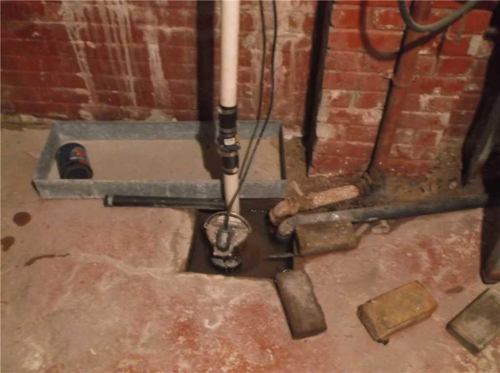 Old Sump Pump in Columbia, SC Basement Replaced with TripleSafe Sump System - Before Photo