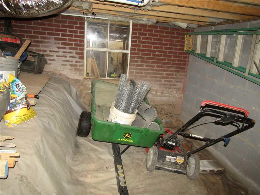 Storage Area Under Asheville, NC Home In Need of CleanSpace Encapsulation - Before Photo