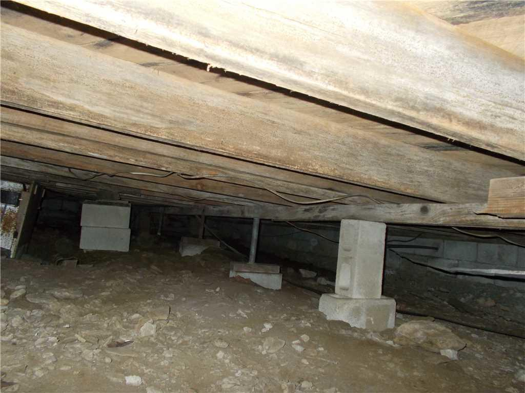 Damp Bryson City, NC Crawlspace with Sagging Floors Has CleanSpace Encapsulation with SmartJacks Installed - Before Photo