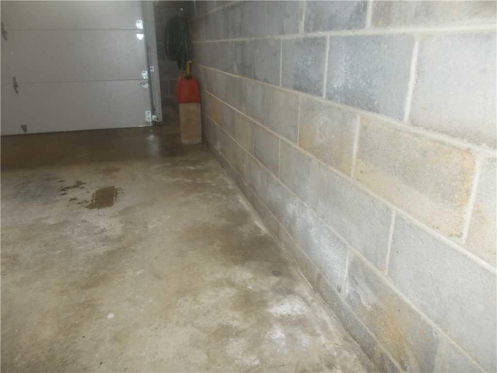 Asheville, NC Basement Receives WaterGuard and SuperSump Pump - Before Photo