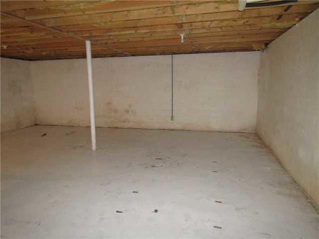 Damp Basement in Maggie Valley, NC Gets WaterGuard and BrightWall