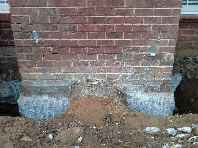 Push Pier Installation in Lyman, SC Corrects Sinking Chimney Foundation