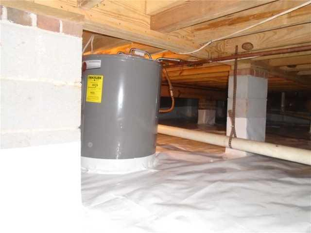 Crawlspace in Moore, SC Dealing with Water Intrusion is Encapsulated with CleanSpace Liner