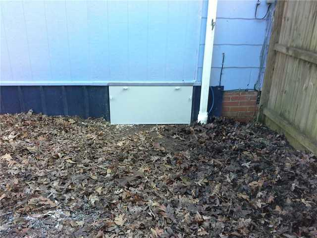 Brevard, NC Crawlspace in Need of New Entrance Gets EverLast Door Installed