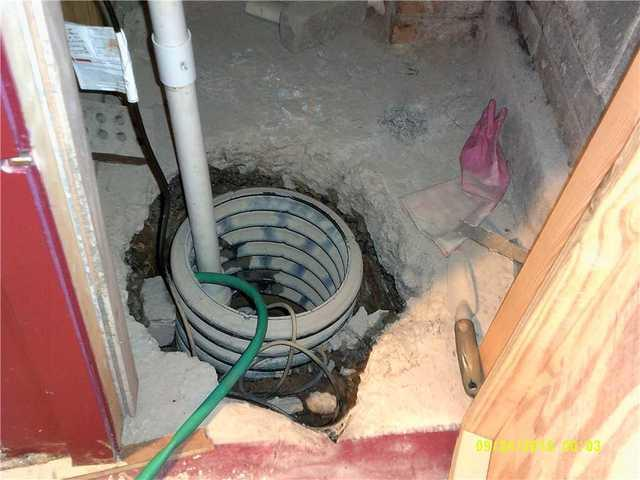 Columbia, SC Homeowner Has New Waterproofing System and SuperSump Installed in Basement - Before Photo