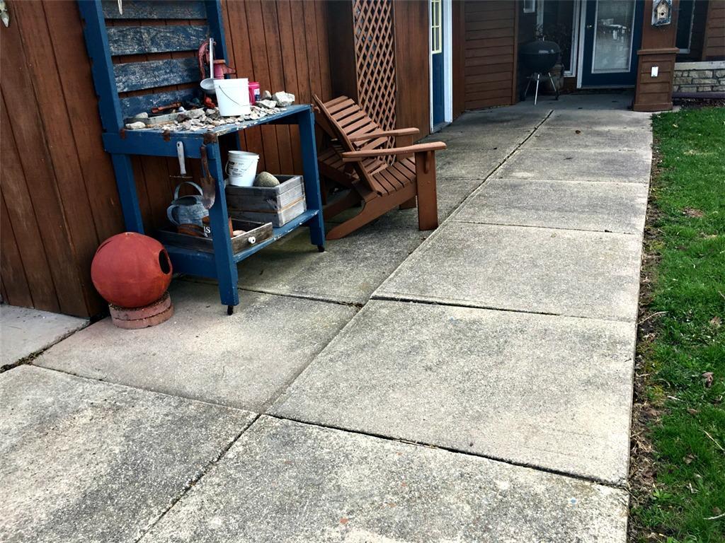 Concrete apron to garage, plus sidewalk, leveled in Rushford, MN - Before Photo
