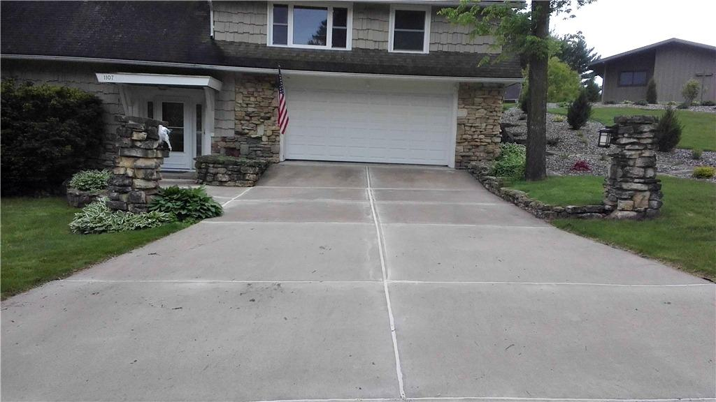 Uneven sidewalk and driveway in Sparta, WI. - After Photo