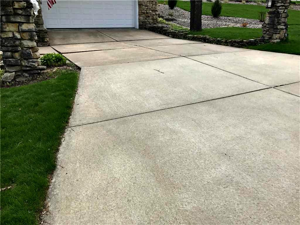 Uneven sidewalk and driveway in Sparta, WI. - Before Photo