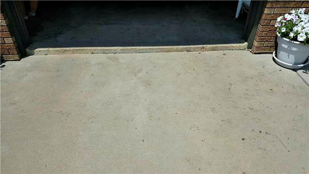 Sunken Concrete Driveway Raised in Adrian, MN - Before Photo