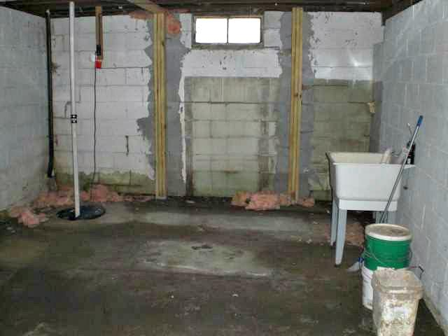 Wet Basement and Damaged Foundation in Oelwein, WI - Before Photo
