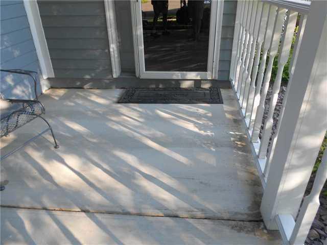 Sinking front porch slab in Rochester MN