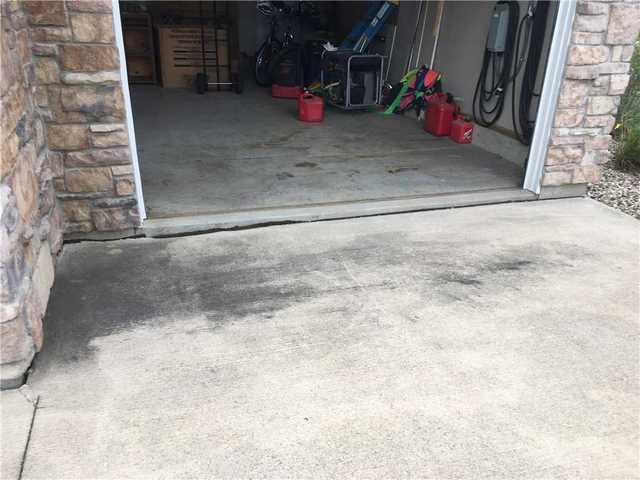 Sinking slab near garage door in Austin, MN