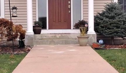 Sunken concrete stoop at residence in Rochester, MN