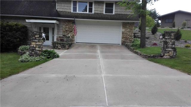 Uneven sidewalk and driveway in Sparta, WI.