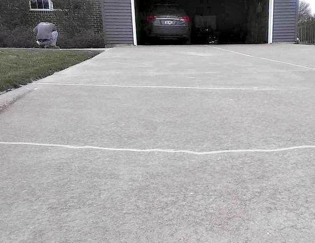 Uneven Concrete Driveway Restored in La Crosse, WI