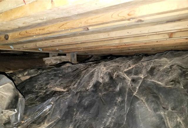 Sunken Floor Beams in Wyoming, MN Home - Before Photo
