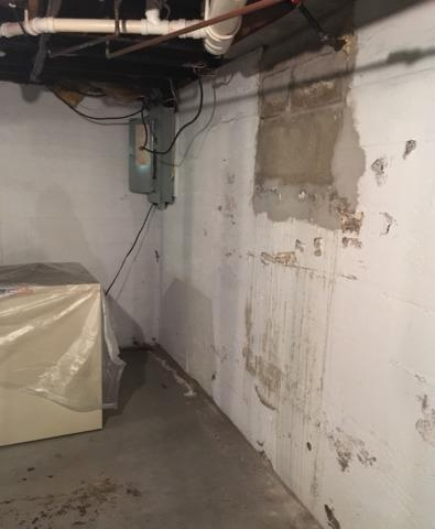 Wet Basement Fixed in Prairie Du Chien, WI - Before Photo