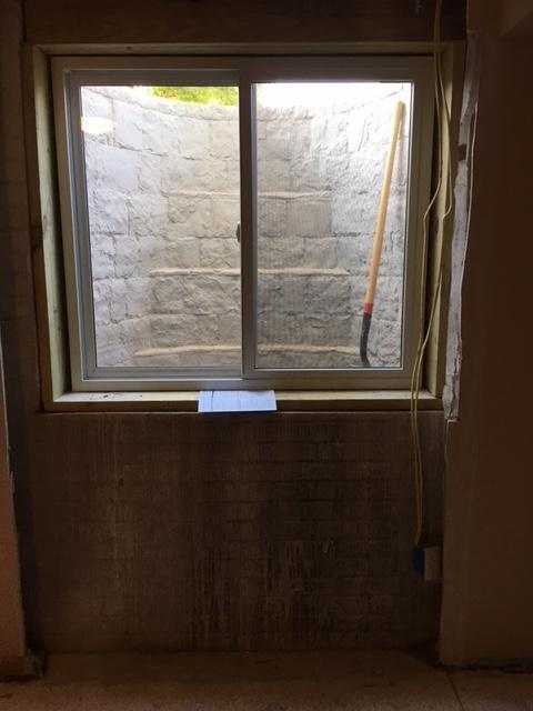 Egress window verses traditional basement window - After Photo