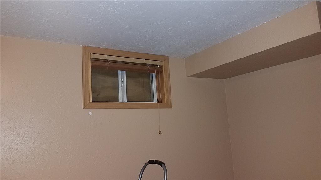 Egress window verses traditional basement window - Before Photo