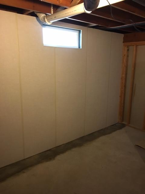 A new window and fresh walls will change the way you look at your basement! - After Photo