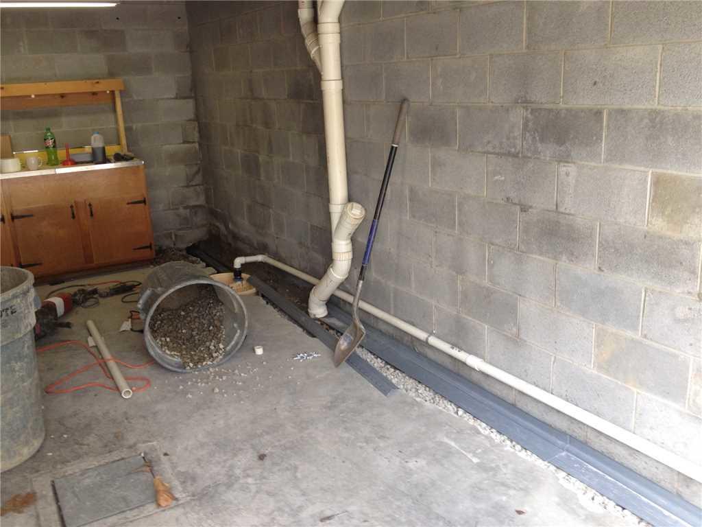 Garage Water Leak Repair in Hopwood PA - Before Photo