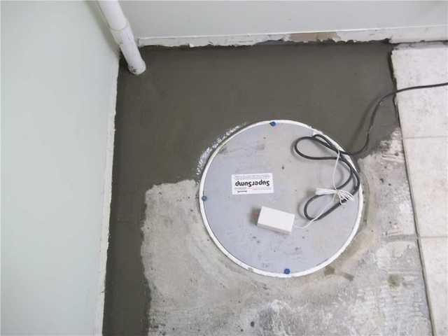 Sump Pump Installed in Pittsburgh, PA Finished Basement