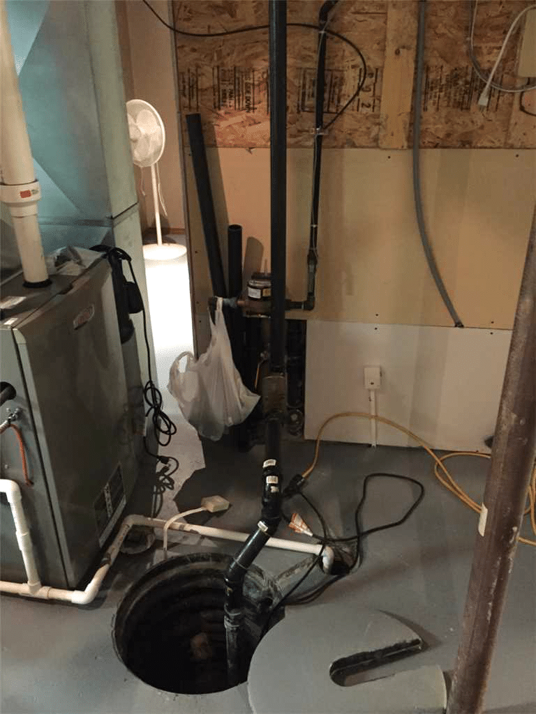 Upgrading an Existing Sump Pump System in Lacombe, AB - Before Photo
