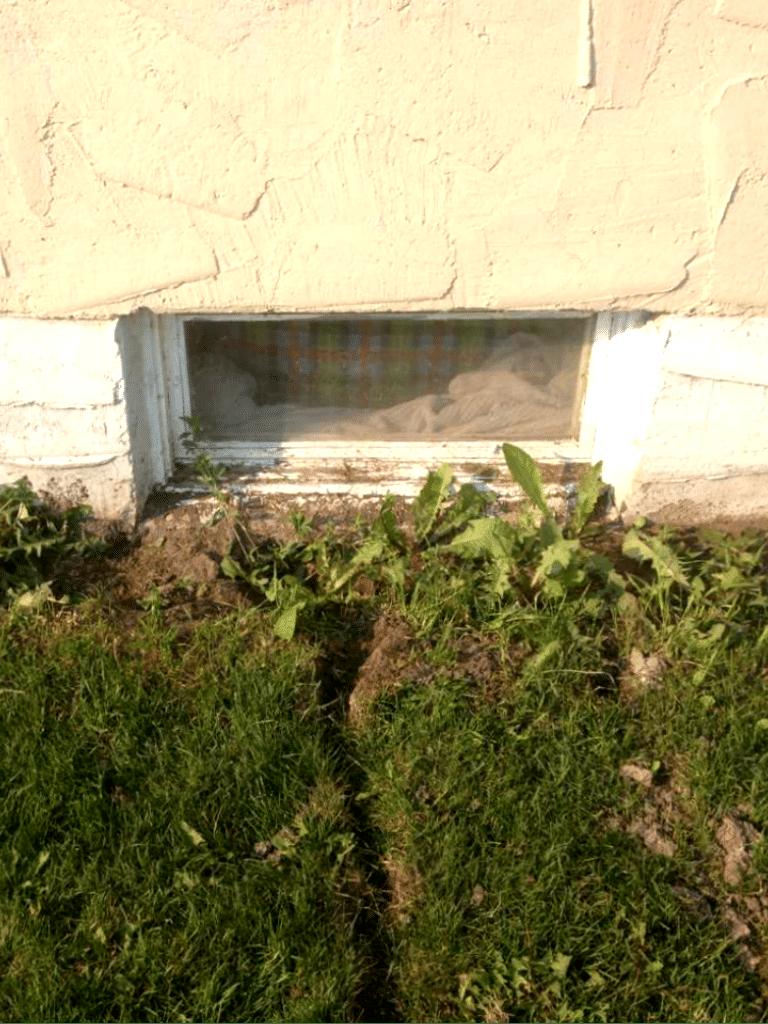 Installing a Window Well in NE Calgary, AB - Before Photo