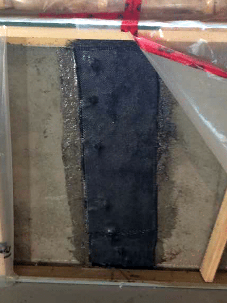 Wall Crack Injection and CarbonArmor® Bi-Directional Wall Stitch in Didsbury, AB - After Photo