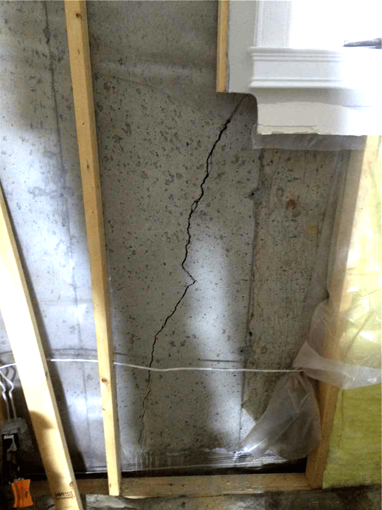 Polyurethane Resin injection and CarbonArmor® Stitch to Repair Foundation Crack in SW Calgary, AB - Before Photo