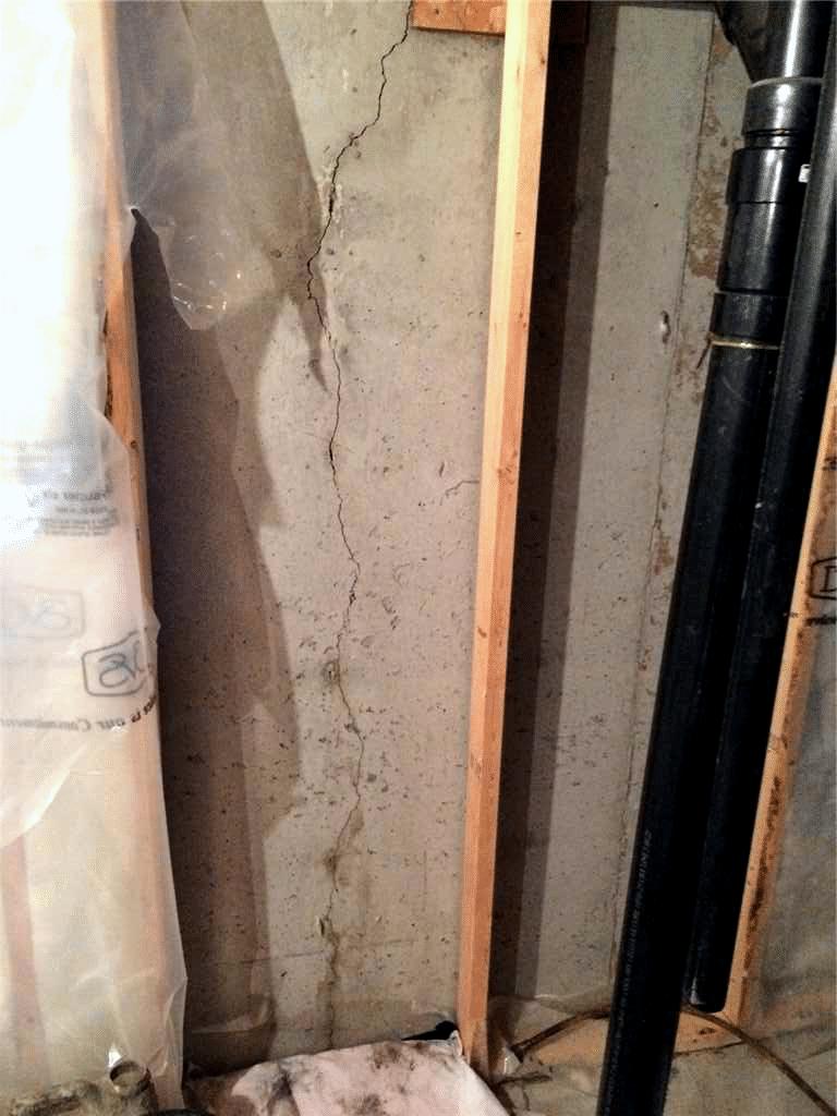 Floor to Ceiling Cracks Repair in NE Calgary, AB - Before Photo
