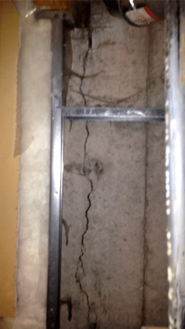 Crack Repair with a Polyurethane Resin Injection and CarbonArmor® Stitches in SE Calgary, AB - Before Photo