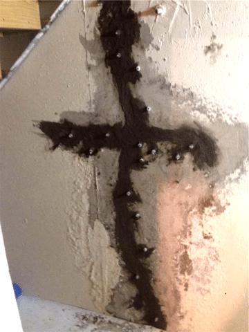 Interesting Cross Shaped Crack in Need of Repair in Drumheller, AB