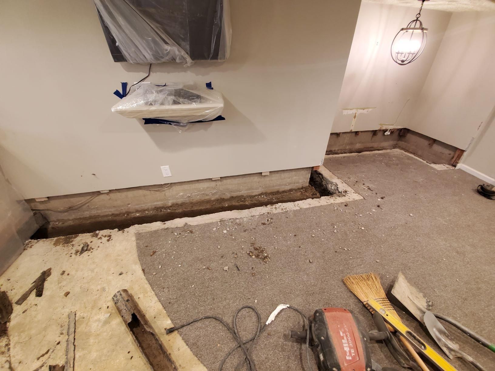 Waterproofing a Finished Basement With Our Patented FlowGuard System And a Gravity Discharge - Goshen, NY - Before Photo