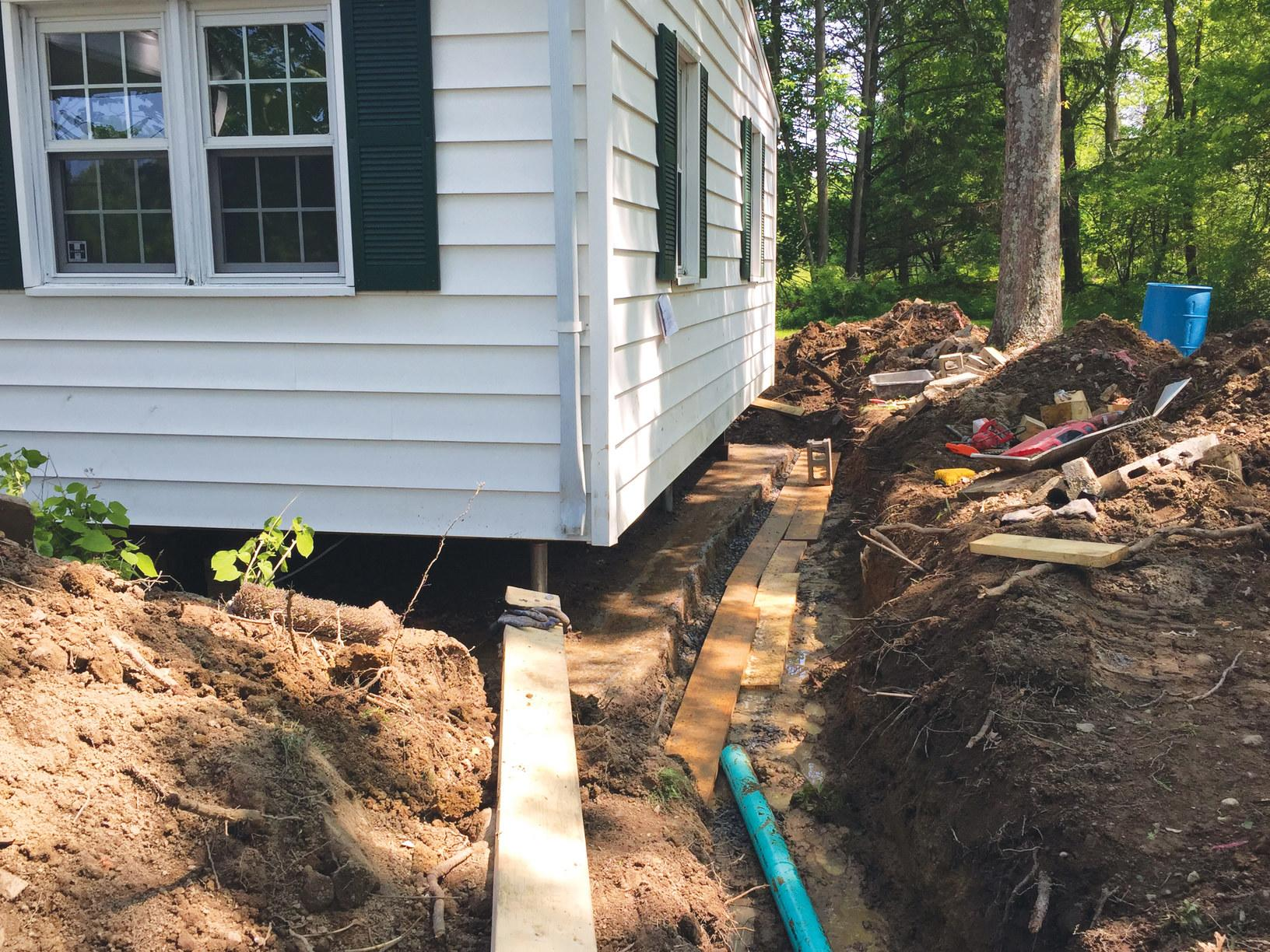 New Foundation & Drainage Line - Before Photo