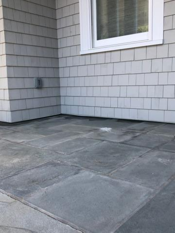 Raising a concrete patio with the help of PolyLevel - Englewood, NJ - Before Photo