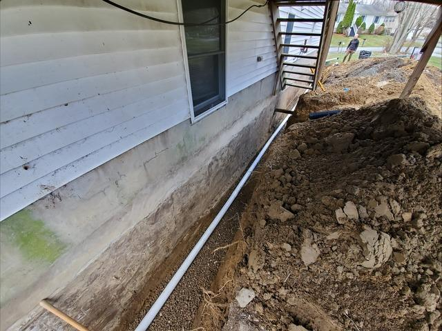 Installing New Footing Drains With Our GMX Waterproofing Coating - Middletown, NY