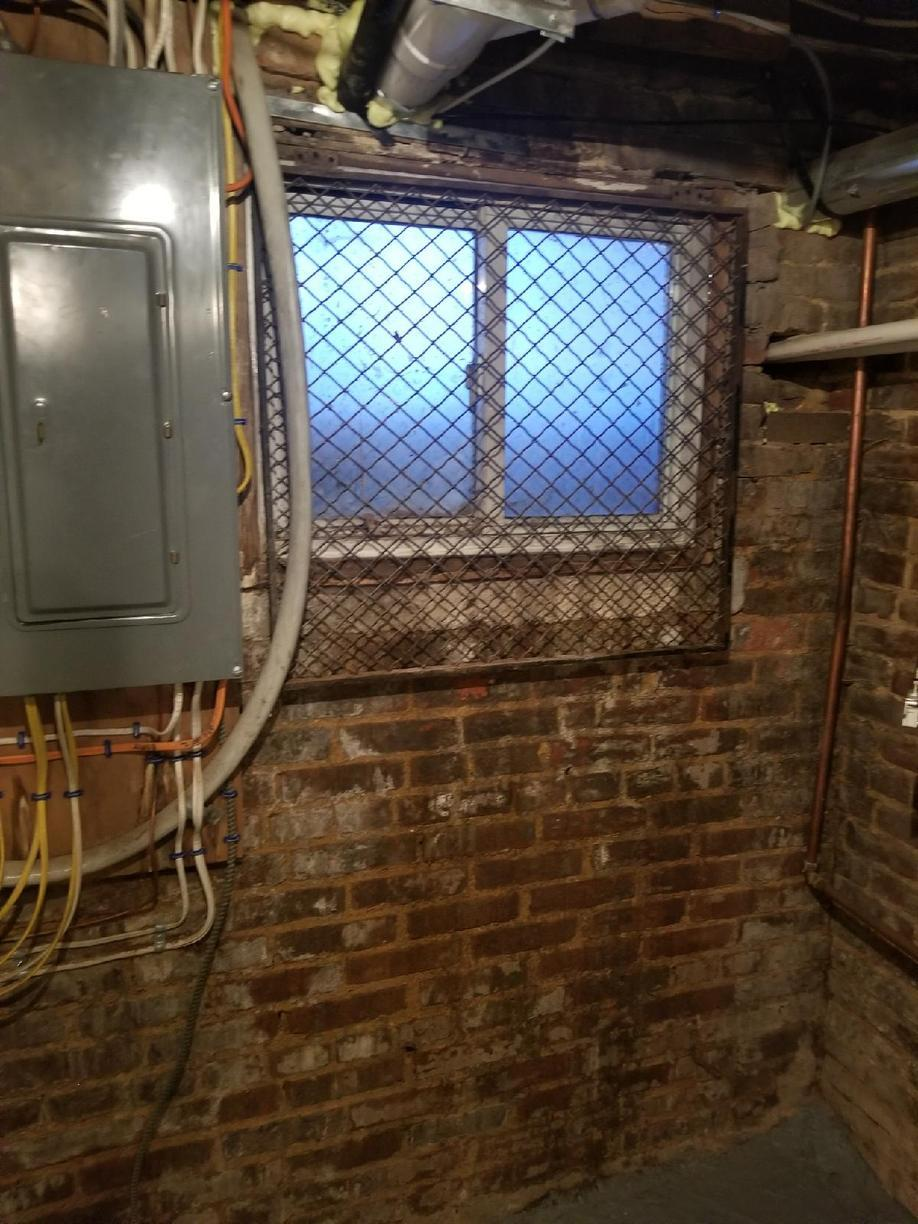 New EverLast Basement Window and WellDuct Window Well Drain in Baltimore City, Maryland - Before Photo