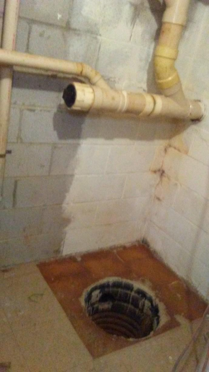 SuperSump System and a SaniDry Sedona = Dry Basement in Owings Mills, MD - Before Photo